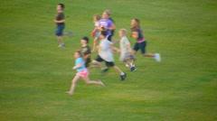 People running across a field Stock Footage