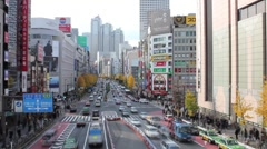 Time-lapse of Park Hyatt Tokyo down busy avenue Stock Footage
