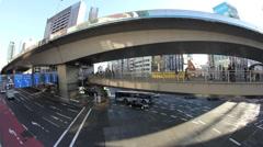 Tokyo traffic time lapse from footbridge Stock Footage
