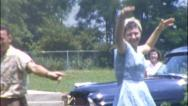 Stock Video Footage of WOMAN DANCES JOKES Near Car 1950 (Vintage 8mm Home Movie Footage) 1ku9