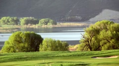 Golfcourse and lake morning Stock Footage