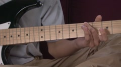 Boy (13-14) playing electric guitar Stock Footage