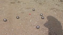people playing petanque on dirt, france - stock footage