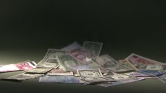 Coins falling on international banknotes, black background, slow motion Stock Footage