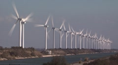 row of wind turbines along canal in camargue, provence, france - stock footage