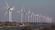 Stock Video Footage of row of wind turbines along canal in camargue, provence, france