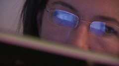 woman surfing internet, reflection in spectacles, close-up - stock footage