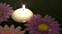 Candles in water - stock footage