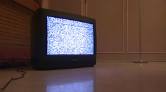 Television displaying static reflected in floor Stock Footage