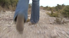 Woman walking on dirt path in nature, provence, france Stock Footage