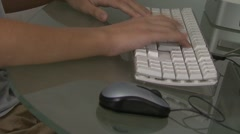 Boy's hands typing on computer keyboard Stock Footage