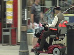 Stock Video Footage of Senior with Disability on Scooter