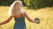 Beautiful young lady spinning in the meadow Stock Footage