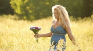 Nice young adult walks in the meadow. Stock Footage