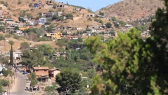 Scan of Hillside houses and the border fence - stock footage