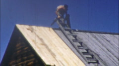 LEAKY ROOF Men Repairing HOME DIY Roofing Cabin Roof Vintage Film Home Movie 2 Stock Footage
