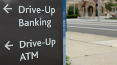 Drive up bank and ATM sign by Street - stock footage