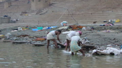Dhobiwallahs wash clothes in the Ganges River  2006 Stock Footage