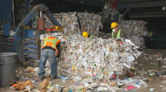 WORKERS BALE RECYCLED PAPER Stock Footage