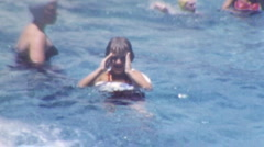 Little Girl Learning To Swim in Public Pool 1950s Vintage Film Home Movie 1kzv Stock Footage