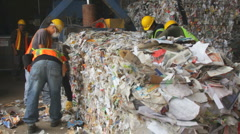 WORKERS WITH RECYCLED PAPER BALES Stock Footage