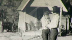 COWBOY ROPE TRICK Hugs Goofy Girlfriend Fun 1930s Vintage Film Home Movie 92 Stock Footage