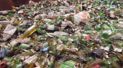 GREEN BOTTLES AWAIT RECYCLING Stock Footage