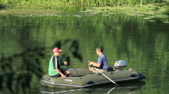 Fishermen catch fish from a boat on the lake. Stock Footage