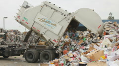 Stock Video Footage of WIDE GARBAGE TRUCK DUMPS RECYCLABLES