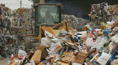 SKIP-LOADER AT RECYCLING PLANT Stock Footage