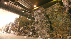 WIDE PAN OF A MOUNTAIN OF RECYCLABLES Stock Footage