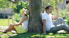 Young couple sitting back to back having relationship difficulties - stock footage