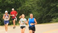 Runners running towards camera(HD)c Stock Footage