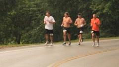 Marathon runners in the rain(HD)c Stock Footage