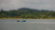 Small blue fishing boat Tilt shilft time lapse HD Stock Footage