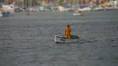 Small fishing boat heads out to sea Tilt shift HD Stock Footage