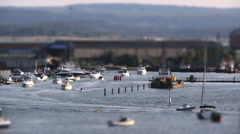 Small boats returning from a day at sea 3 Tiltshift HD Stock Footage