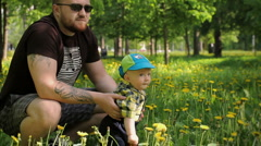 03 Brutal dad playing with son in park Stock Footage