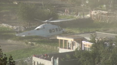 Helicopter lands near Pakistan refugee camp Stock Footage