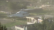 Stock Video Footage of Helicopter lands near Pakistan refugee camp