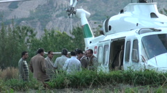High Pakistani officials waiting to board helicopter - stock footage