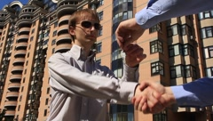 Business handshake and giving the keys - stock footage