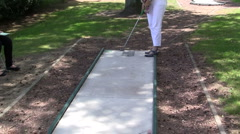 playing mini golf - stock footage