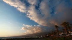 Sky clouds at sunset, ocean, mountain - beach resort town Stock Footage