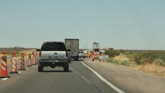 Line of vehicles moving towards the American border Stock Footage