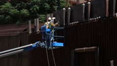 Men Working on Fence At US-Mexico Border In Arizona (HD) c - stock footage