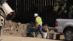 Men Working on Fence At US-Mexico Border In Arizona (HD) c Stock Footage