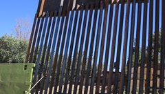 Pan of Fence of US-Mexico Border in Arizona (HD) c Stock Footage