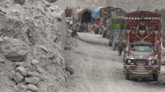 Aid trucks waiting near Attabad lake, disaster area Stock Footage