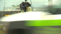 Broadcast television cameraperson and camera outdoors #2 Stock Footage